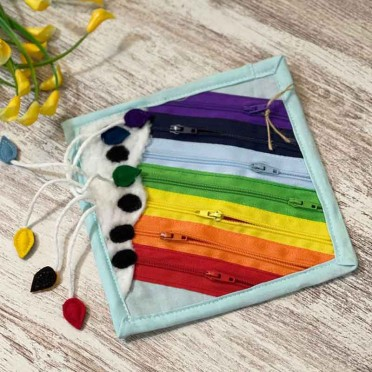Zippers-Rainbow Learning Panel, front view