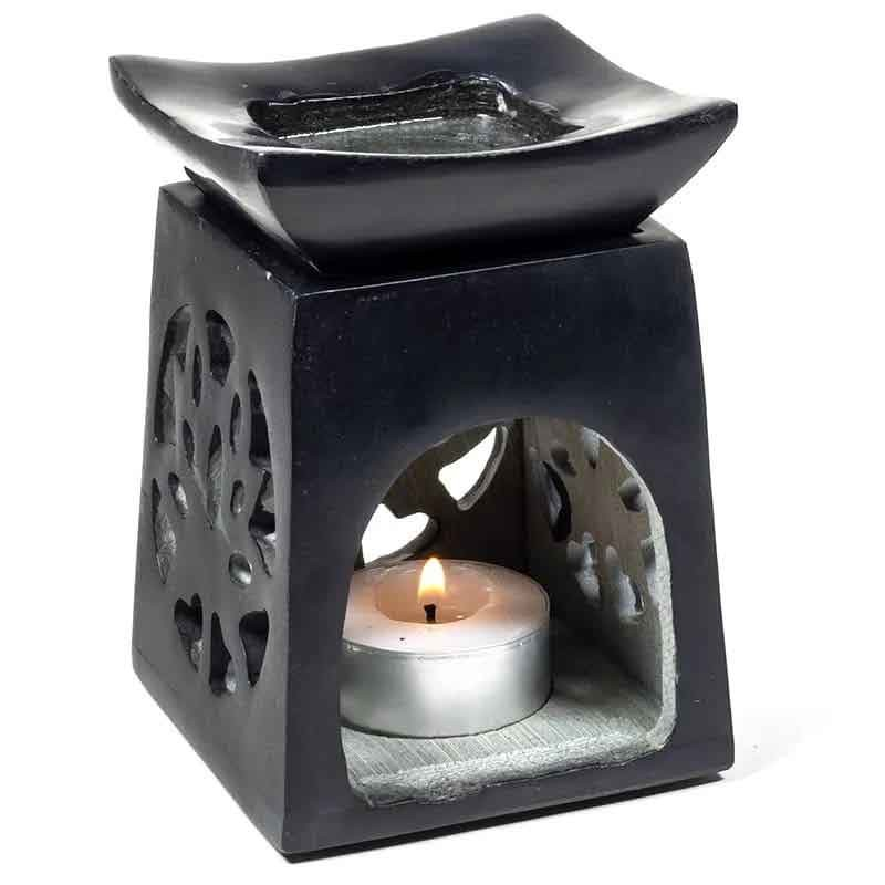 Black soapstone essence burner with lotus flower, front view