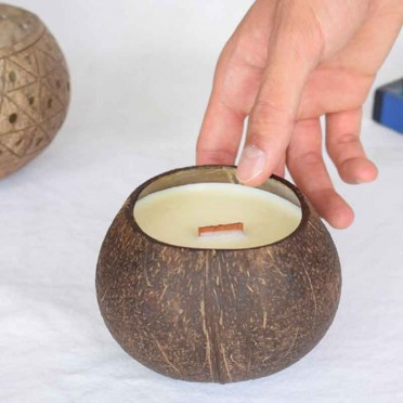 Soy wax candle, passion fruit essence. In coconut shell, top view